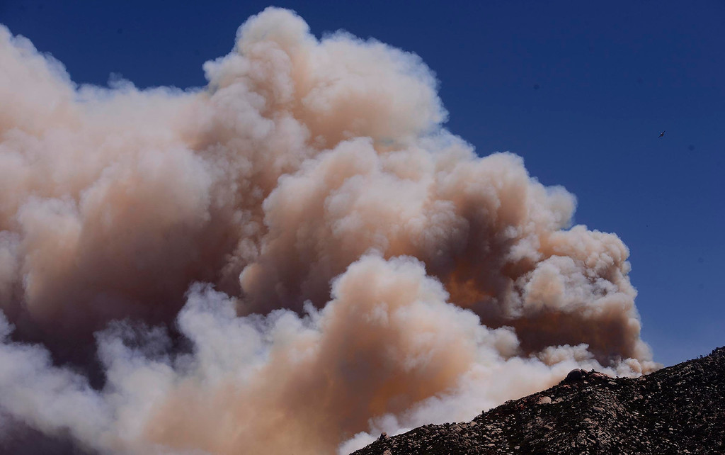 . Smoke from the Silver Fire billows atop a ridge as seen from Twin Pines Ranch in the mountains south of Banning August 8, 2013.   GABRIEL LUIS ACOSTA/STAFF PHOTOGRAPHER.