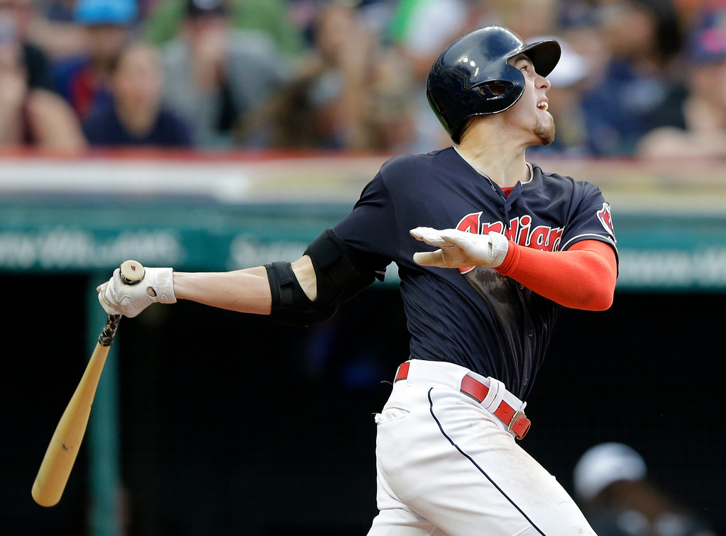 . Cleveland Indians\' Bradley Zimmer watches his RBI sacrifice fly off San Diego Padres starting pitcher Dinelson Lamet during the third inning of a baseball game, Thursday, July 6, 2017, in Cleveland. (AP Photo/Tony Dejak)
