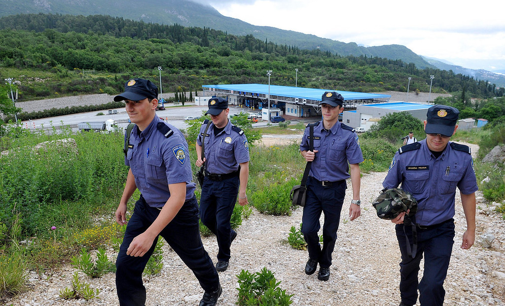 . Croatian border police officers patrol along the border between Croatia and Montenegro, close to the Croatian village of Karasovici on June 5, 2013. Croatian border is expected to become the most Southern border of the EU after the country joins the bloc on July 1, 2013.  Croatia is gearing up to lavishly celebrate joining the European Union on July 1, but economic worries are overshadowing the festivities planned to mark the successful end of the Balkan country\'s 10-year bid for membership.  ELVIS BARUKCIC/AFP/Getty Images