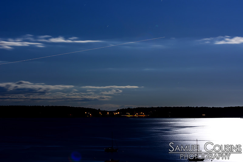 Looking out over Casco Bay at night. This is a long (30 second) exposure, which makes the sky look almost like day.
