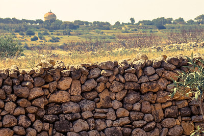 I stepped off the bus prematurely which left me walking a pretty good distance (and a hill to climb) before reaching the one-time social/civic center of Malta. The medieval village of Mdina is surrounded by swaths of patchwork farmland, stone walls, dry wind, and the distance sea. The inner pathways of the village are alluringly alive and inviting.
