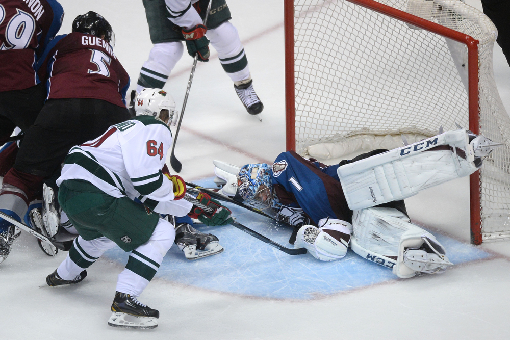 . Semyon Varlamov (1) of the Colorado Avalanche stops a shot attempt by Mikael Granlund (64) of the Minnesota Wild during the third period of action. The Colorado Avalanche hosted the Minnesota Wild during the first round of the NHL Stanley Cup Playoffs at the Pepsi Center on Thursday, April 17, 2014. (Photo by Karl Gehring/The Denver Post)