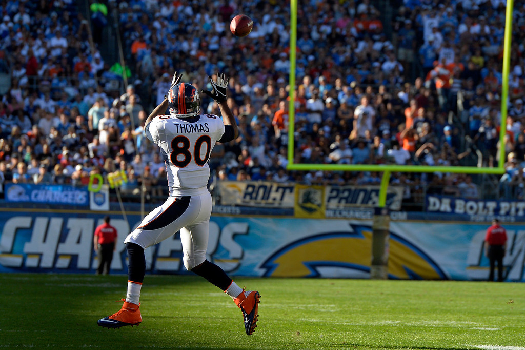 . SAN DIEGO, CA. - November 10: Tight end Julius Thomas #80 of the Denver Broncos makes an open field catch in the first half at Qualcomm Stadium November 10, 2013 San Diego, CA. (Photo By Joe Amon/The Denver Post)
