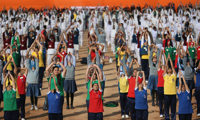 . Indian school children perform Surya Namaskar or Sun salutation during a function to mark 150th birth  anniversary of Swami Vivekananda, in New Delhi, India, Monday, Feb. 18, 2013. Hundreds of school children across India performed Surya Namaskar, a Yoga posture which comprises 12 different bodily postures that ought to be performed in particular sequence. Swami Vivekananda, an Indian Hindu monk, who spread the message of India\'s spiritual heritage across the world. (AP Photo/Manish Swarup)
