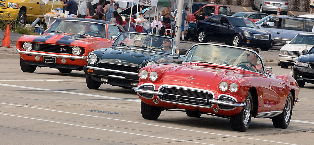. Cruisers head south on Woodward Avenue in Pontiac during the 2013 Woodward Dream Cruise, Saturday August 17, 2013. (Oakland Press Photo:Vaughn Gurganian)