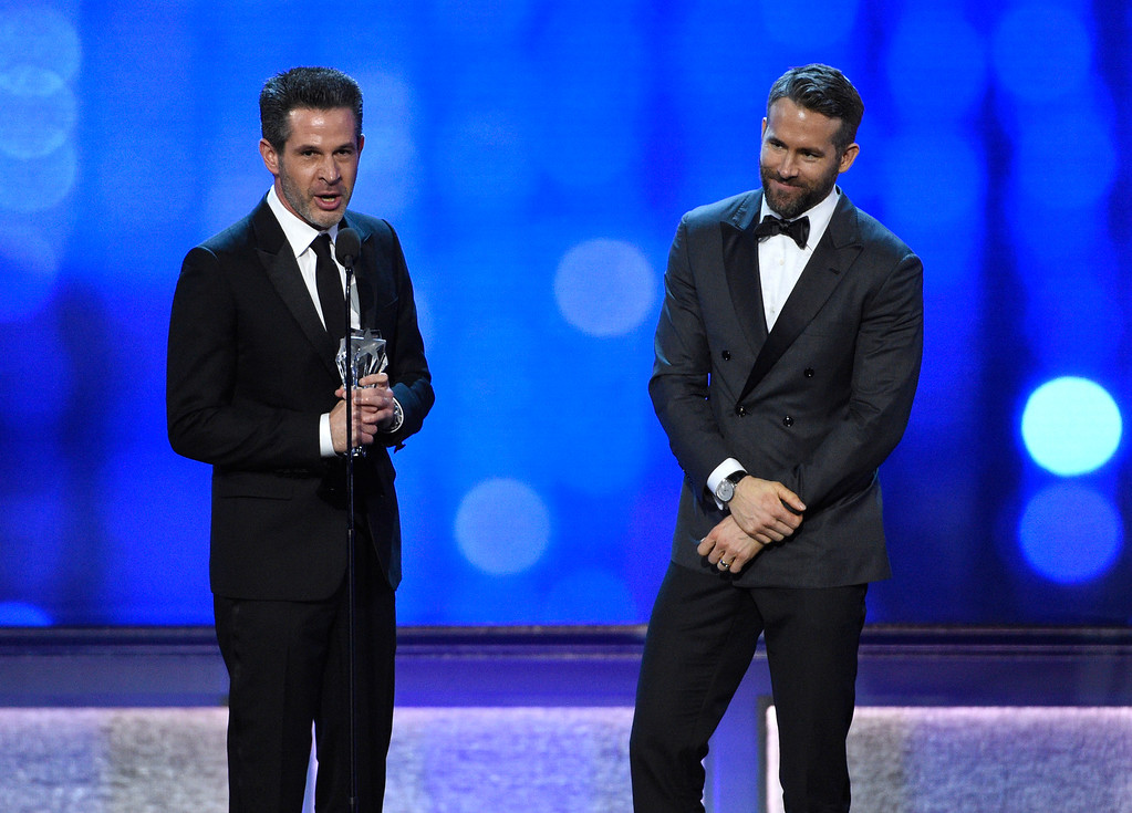 """. Simon Kinberg, left, and Ryan Reynolds accept the award for best comedy for \""""Deadpool\"""" at the 22nd annual Critics\' Choice Awards at the Barker Hangar on Sunday, Dec. 11, 2016, in Santa Monica, Calif. (Photo by Chris Pizzello/Invision/AP)"""