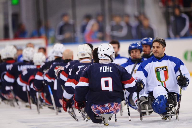 . Andy Yohe of the United States shakes hands with Valerio Corvino of Italy after the Ice Sledge Hockey Preliminary Round Group A match between the United States of America and Italy at Shayba Arena on March 8, 2014 in Sochi, Russia.  (Photo by Dennis Grombkowski/Getty Images)