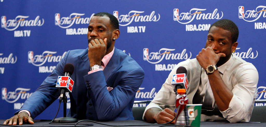 . Miami Heat\'s LeBron James, left, and Dwyane Wade listen to a question during a news conference after Game 6 of the NBA Finals basketball game against the Dallas Mavericks Sunday, June 12, 2011, in Miami. The Mavericks won 105-95 to win the series. (AP Photo/Wilfredo Lee)