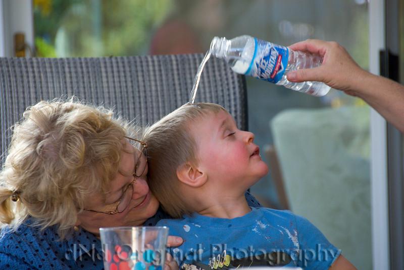 042 Brielle(1) & Ian(2) Birthday Party - Jill Pouring Water Onto Ian's Head.jpg