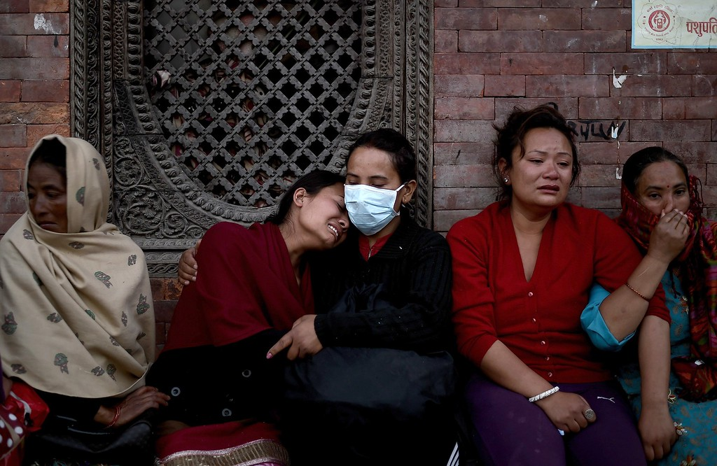 . Sarina Shrestha (2L) breaks down during the cremation of her father Ram Bahadur Shrestha on the banks of Bagmati river at the Pasupathinath temple in Kathmandu on April 29, 2015.  The United Nations appealed for $415 million for Nepal, saying it urgently needs more funds to provide relief to people affected by a devastating earthquake.      AFP PHOTO / MANAN VATSYAYANA/AFP/Getty Images