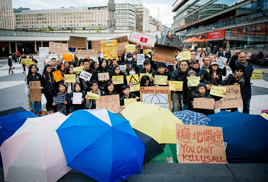 ". Pro-democracy protesters demonstrate in support of the demonstrations currently blocking central Hong Kong that have been dubbed the ""umbrella revolution\"", on October 1, 2014 in Stockholm, Sweden. Hong Kong has been plunged into the worst political crisis since its 1997 handover as pro-democracy activists take over the streets following China\'s refusal to grant citizens full universal suffrage.JONATHAN NACKSTRAND/AFP/Getty Images"
