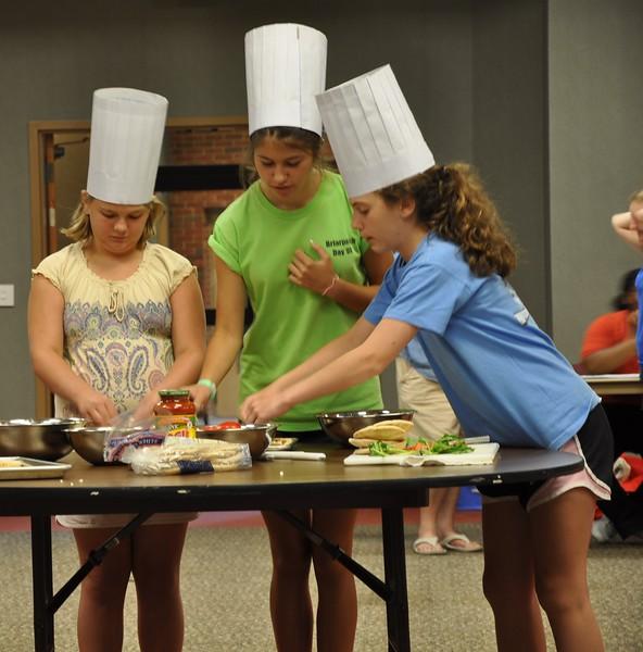 teens adding sauce, tomatoes, herbs, & homemade mozzarella.jpg