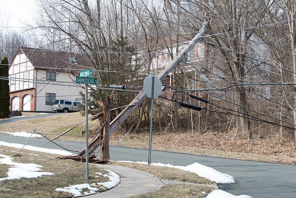 02/25/19 Wesley Bunnell | Staff High winds caused a large tree to fall near the intersection of Farmstead Rd and Hightower Rd in Southington pulling down electrical wires and snapping an electrical pole at the base.