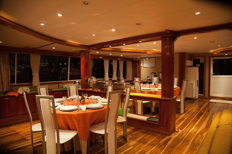 The dining area aboard Queen of Galapagos.