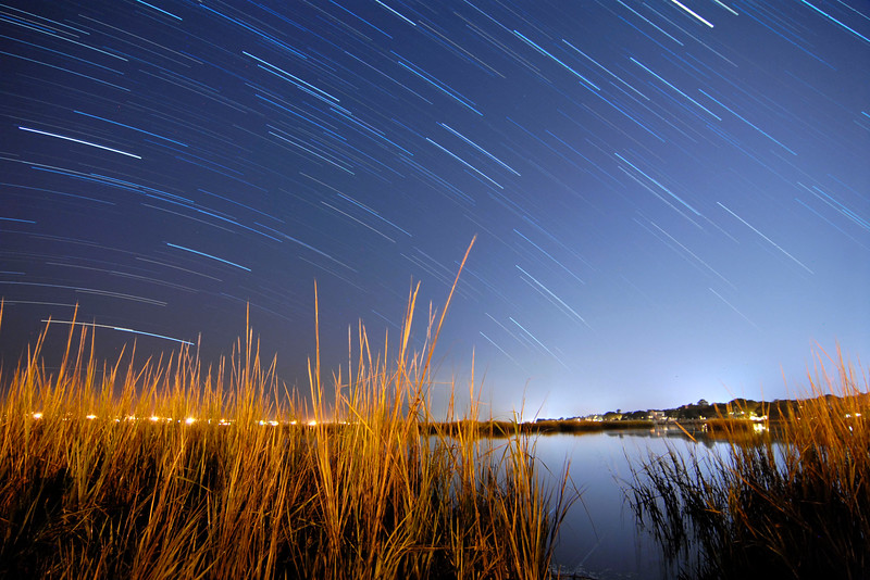 Star trails over the marshes with light pollution from nearby Murrells Inlet in Garden City Beach, South Carolina on Monday, November 21, 2011. Copyright 2011 Jason Barnette  SPECIAL DONATION TO THE INTERNATIONAL DARK-SKY ASSOCIATION: I will donate 20% of all print sales of this photo to the International Dark-Sky Association to help with their fight to preserve the night!