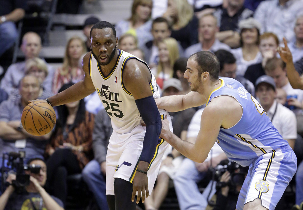 . Denver Nuggets\' Kosta Koufos, right, guards Utah Jazz\'s Al Jefferson (25) in the first quarter during an NBA basketball game on Wednesday, April 3, 2013, in Salt Lake City. (AP Photo/Rick Bowmer)
