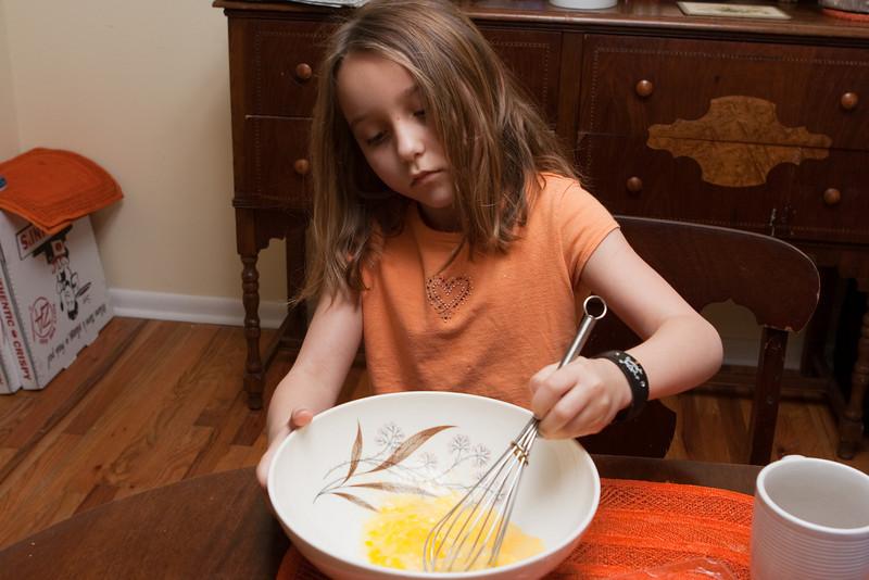 Arayana whisks eggs.