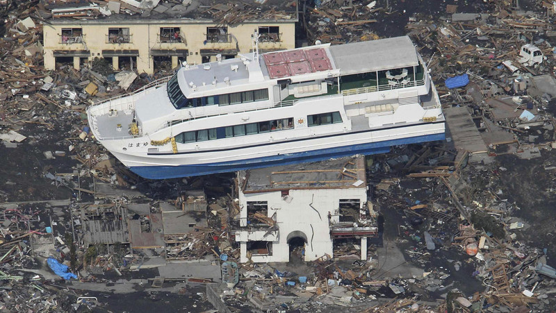 . A ferry stranded on a building is seen in Otsuchi, Iwate Prefecture, northern Japan, Sunday, March 13, 2011, two days after a powerful earthquake-triggered tsunami hit the country\'s east coast. (AP Photo/The Yumiuri Shimbun)
