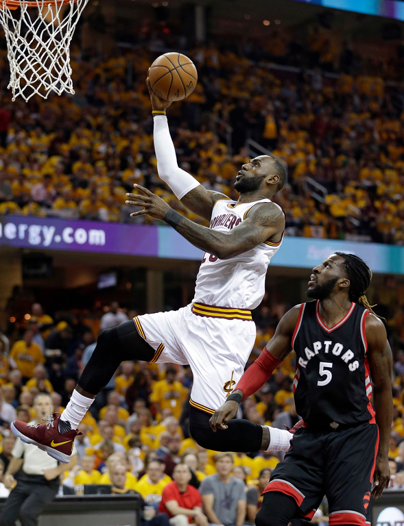 . Cleveland Cavaliers\' LeBron James (23) drives past Toronto Raptors\' DeMarre Carroll (5) in the first half in Game 1 of a second-round NBA basketball playoff series, Monday, May 1, 2017, in Cleveland. (AP Photo/Tony Dejak)