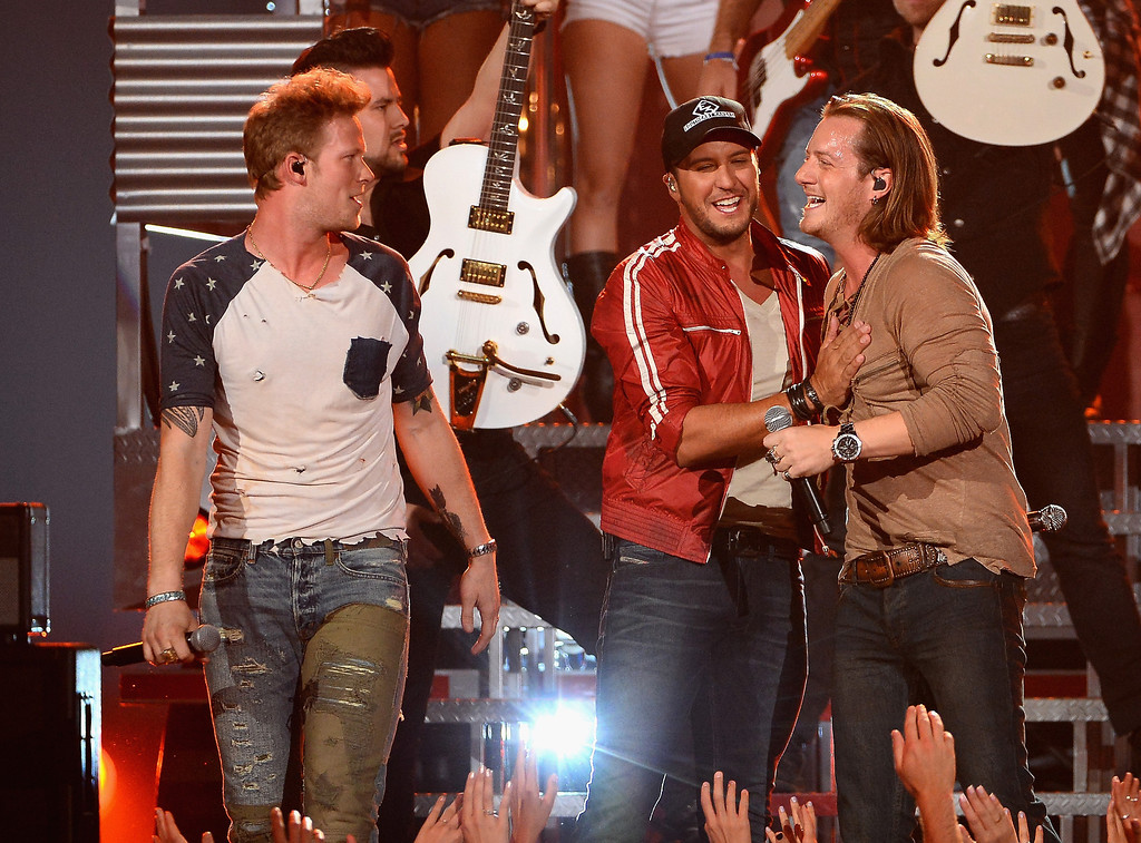 . Recording artist Luke Bryan (C) and Florida Georgia Line members Brian Kelley (L) and Tyler Hubbard (R) perform onstage during the 2014 Billboard Music Awards at the MGM Grand Garden Arena on May 18, 2014 in Las Vegas, Nevada.  (Photo by Ethan Miller/Getty Images)