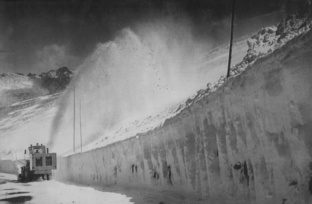 . A snow plow leaves a wall of snow in its wake as it clears a section of Trail  Ridge Road at the 12,000-foot level of Rocky Mountain National Park in 1981.  Credit: AP Laserphoto