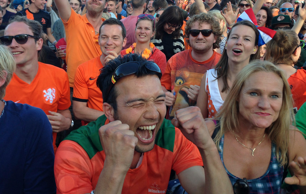 . Festival goers celebrate as they watch the 2-1 win of the Dutch team in the World Cup round of 16 soccer match between the Netherlands and Mexico on the last day of the \'Down the Rabbit Hole\' music festival in Beuningen, near Nijmegen, Sunday June 29, 2014. (AP Photo/Peter Dejong)