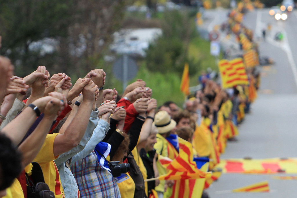 . Activists calling for the independance of Catalonia, currently a region of Spain, take part in a \'human chain\' during a protest on September 11, 2013, in Perthus, southern France. Independence-seeking Catalans marshalled their forces today for a 400-kilometre (250-mile) human chain in a bold push to break from Spain despite fierce opposition from Madrid. RAYMOND ROIG/AFP/Getty Images