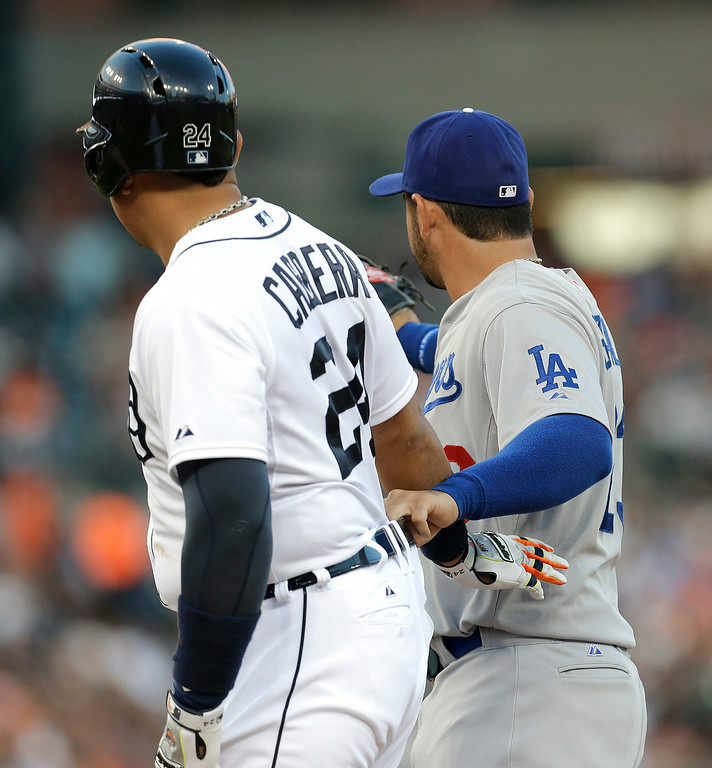 . Los Angeles Dodgers first baseman Adrian Gonzalez, right, playfully grabs Detroit Tigers\' Miguel Cabrera by the belt after hitting a single in the fourth inning of a baseball game in Detroit, Tuesday, July 8, 2014. (AP Photo/Paul Sancya)