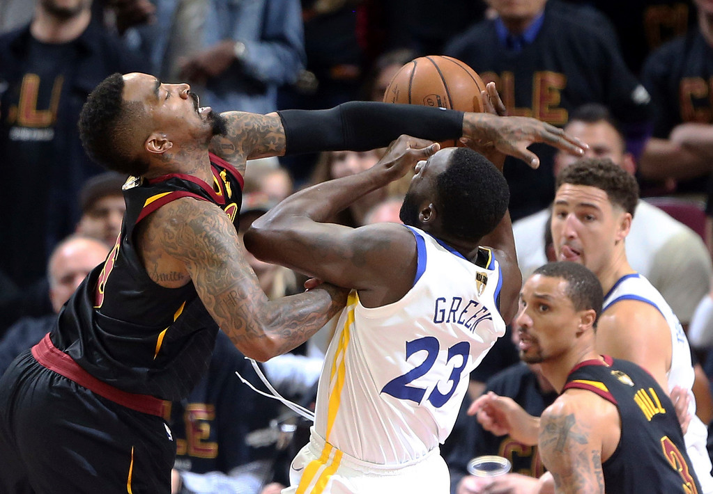 . Cleveland Cavaliers guard JR Smith fouls Golden State Warriors forward Draymond Green on a drive to the basket during the first half of Game 3 of basketball\'s NBA Finals on Wednesday, June 6, 2018, in Cleveland. (Joshua Gunter/The Plain Dealer via AP)