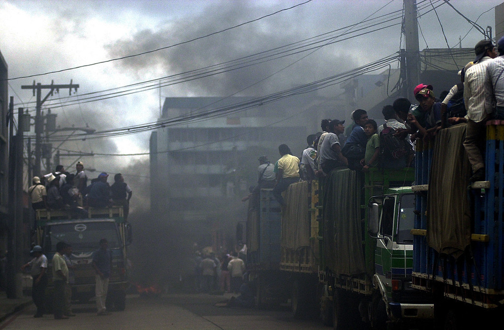 . Supporters of former dictator Efrain Rios Montt mount transports to downtown  Guatemala City, Thursday July 24, 2003. A television reporter of Channel 7 apparently died of a heart attack while fleeing from a mob that was chasing reporters who were covering the demonstration. (AP Photo/Rodrigo Abd)