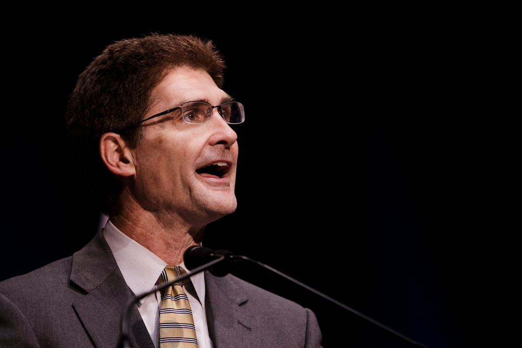 . Carl Guardino, CEO of Silicon Valley Leadership Group, speaks of Reed\'s role as mayor, before Reed\'s annual state of the city speech at the San Jose Civic Auditorium on Feb. 7, 2013. (Dai Sugano/Staff)
