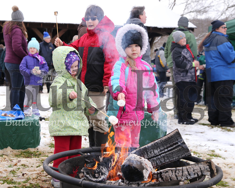 Lilith(left) and Astrid Thompson  of Slippery Rock roast marshmallows for smores at Moraine State Park's Winterfest Saturday. Seb Foltz/Butler Eagle