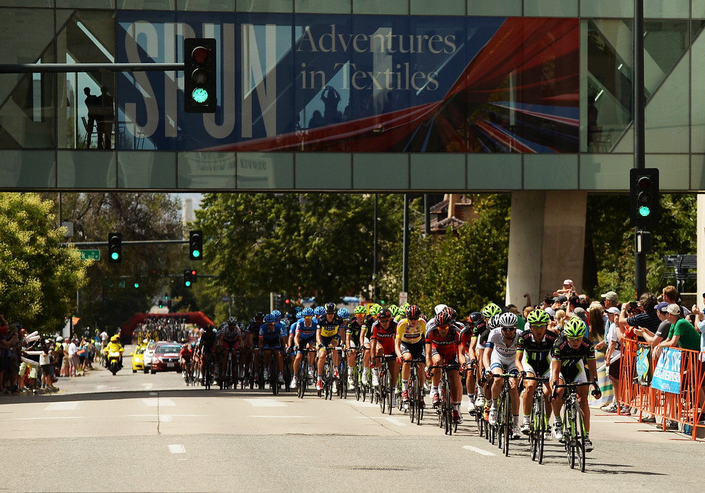 . Cyclists pass by the Denver Art Museum during the 75-mile 7th stage of the 2013 USA Pro Challenge race in Denver, Colorado on August 25, 2013. (Photo by Hyoung Chang/The Denver Post)