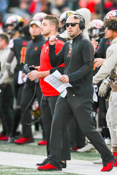 Maryland interim head coach Matt Canada celebrates a key defensive stop