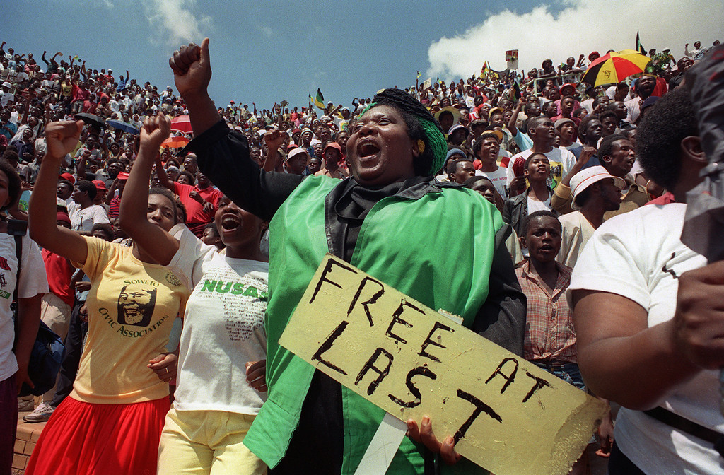 . Jubilant inhabitants of Soweto attend a mass african National Congress (ANC) rally to be addressed by freed anti-apartheid leader and African National Congress (ANC) member Nelson Mandela at Orlando stadium in Soweto, 12 February 1990. It\'s the first rally Nelson Mandela held since his release from jail, 11 February 1990. The rally was originally called for to celebrate the unbanning of the ANC but turned out to be a celebration for the release from jail of Nelson Mandela.        (PHILIP LITTLETON/AFP/GettyImages)