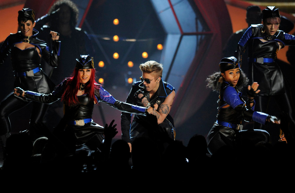 . Justin Bieber, center, performs at the Billboard Music Awards at the MGM Grand Garden Arena on Sunday, May 19, 2013 in Las Vegas. (Photo by Chris Pizzello/Invision/AP)