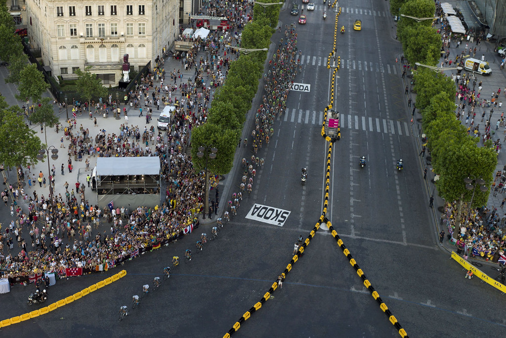 . The pack rides on the Champs Elysees avenue in Paris during the 133.5 km twenty-first and last stage of the 100th edition of the Tour de France cycling race on July 21, 2013 between Versailles and Paris.  FRED DUFOUR/AFP/Getty Images