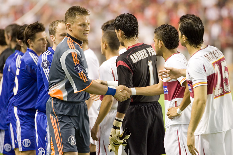 Players shaking hands