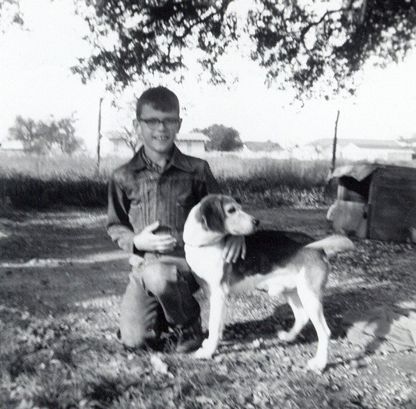 "JERRY AND ME This is Grandpa's old beagle, Jerry, a true watchdog in the strictest sense of the word. He would bellow ""ROWF, ROWF, ROWF!"" at whoever's car would happen to drive up and usually wouldn't stop until someone came over and said Hello properly. What a great dog he was. This is 1961."