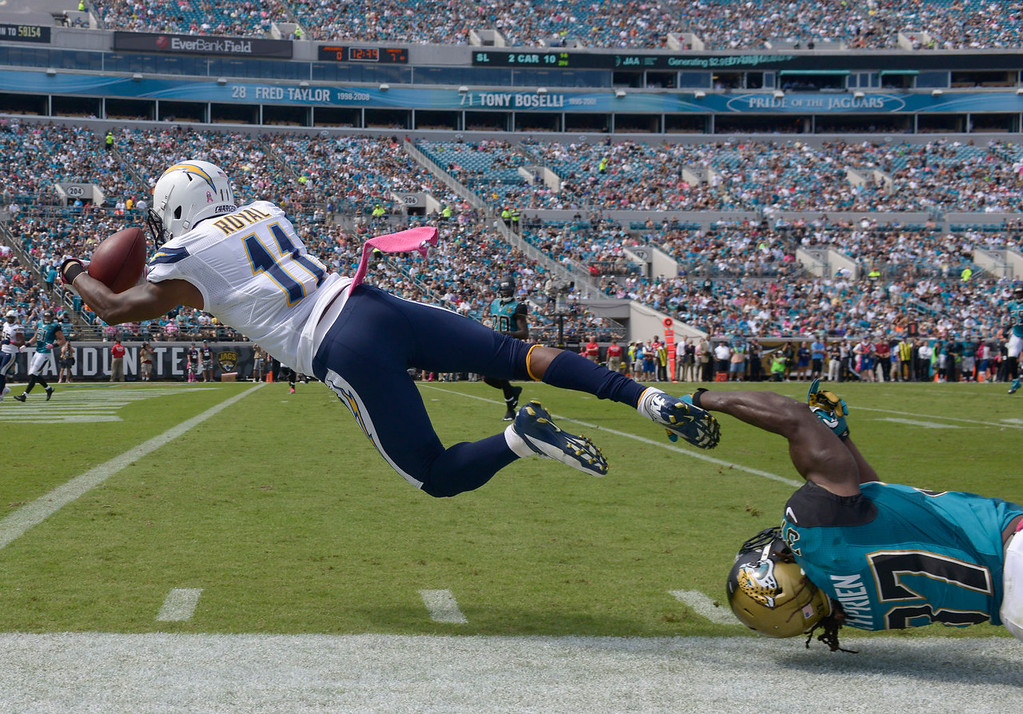 . San Diego Chargers wide receiver Eddie Royal (11) catches a 27-yard pass for a touchdown as Jacksonville Jaguars strong safety Johnathan Cyprien, lower right, can\'t stop him during the first half of an NFL football game in Jacksonville, Fla., Sunday, Oct. 20, 2013.(AP Photo/Phelan M. Ebenhack)