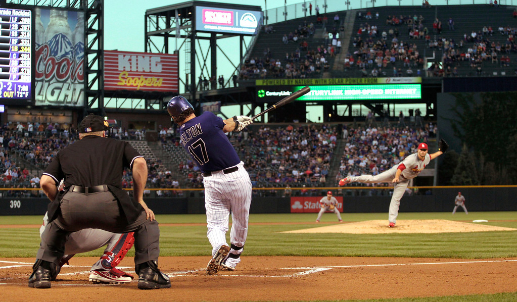 . Colorado Rockies batter Todd Helton (17) swings at a pitch from  St. Louis Cardinals starting pitcher Lance Lynn during the first inning of a baseball game in Denver on Monday, Sept. 16, 2013. Helton announced Monday that he was retiring from baseball at the end of the season. (AP Photo/Joe Mahoney)