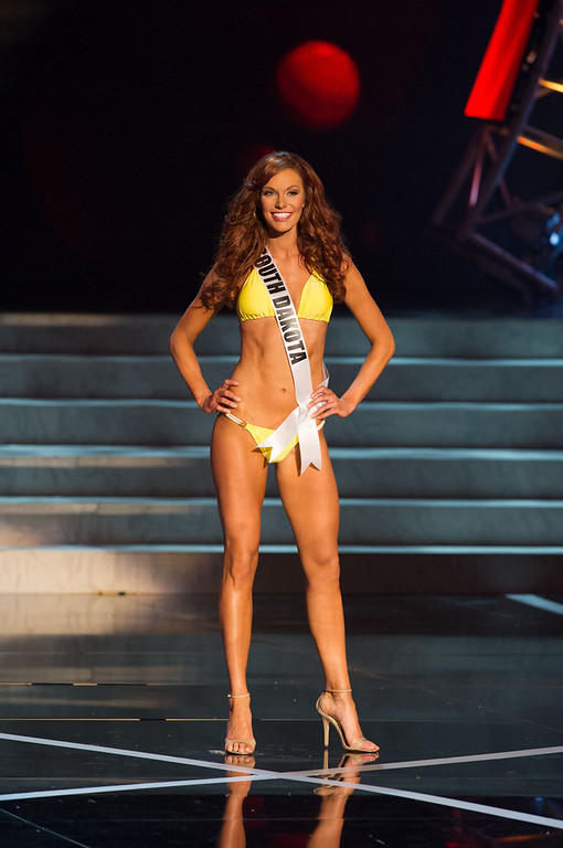 . In this photo provided by the Miss Universe Organization,  Miss South Dakota USA 2013, Jessica Albers,  competes in her swimsuit during the  2013 Miss USA Competition Preliminary Show in Las Vegas on Wednesday June 12, 2013.   She will compete for the title of Miss USA 2013 and the coveted Miss USA Diamond Nexus Crown on June 16, 2013.  (AP Photo/Miss Universe Organization, Darren Decker)