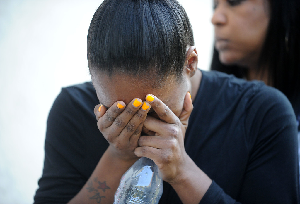 . Brea Colbert, left, breakdowns in tears while talking to reporters with her sister Raquel Suarez, of San Leandro, at her side in Oakland, Calif., on Saturday, July 20, 2013. Colbert\'s two children were shot and wounded and their friend Alaysha Carradine, 8, was killed when a gunman fired multiple shots into the apartment after Alaysha\'s friend opened the front door at 11:18 p.m. on Wednesday, July 17. No arrests have been made in the case. (Doug Duran/Bay Area News Group)