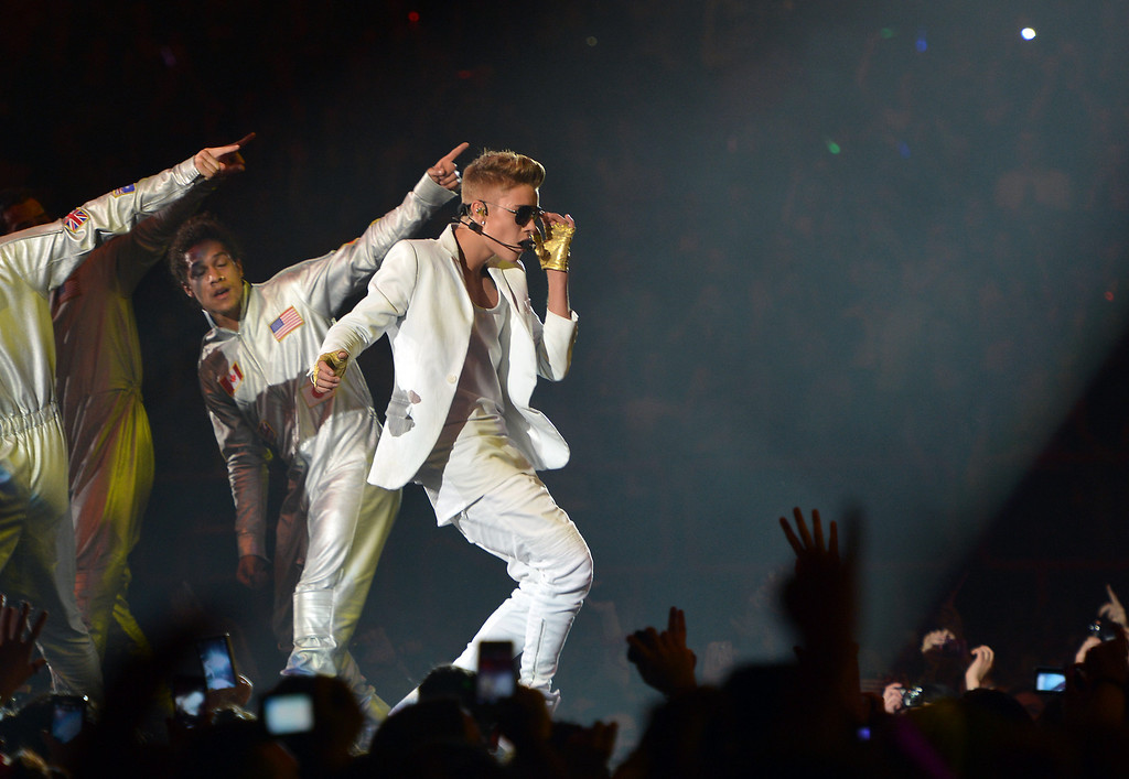 """. Canadian singer Justin Bieber performs during a concert as part of his \""""I Believe\"""" tour at the Palais Omnisport de Paris-Bercy (POPB), on March 19, 2013.            (MIGUEL MEDINA/AFP/Getty Images)"""