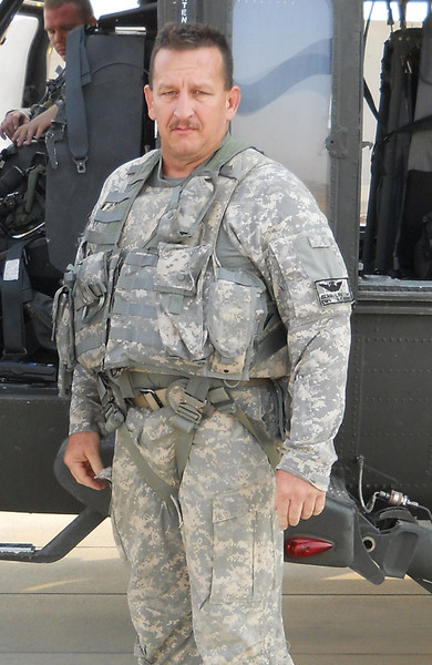 Deacon Leo Blasi at a forward operating base at Garry Owen, in Iraq in 2010. Deacon Blasi served in Bosnia from 2002 to 2003 and Iraq from 2009 to 2010, as well as assisted via the National Guard at fight fires in California in 2005, the aftermath of Hurricane Katrina in Louisiana in 2005 and by carrying hay bales to stranded cattle in western Kansas in 2007. Register File Photo.