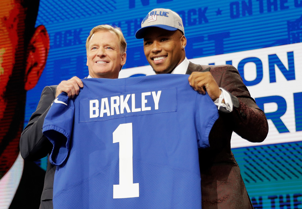 . Penn State\'s Saquon Barkley, right, poses with commissioner Roger Goodell after being selected by the New York Giants during the first round of the NFL football draft, Thursday, April 26, 2018, in Arlington, Texas. (AP Photo/David J. Phillip)