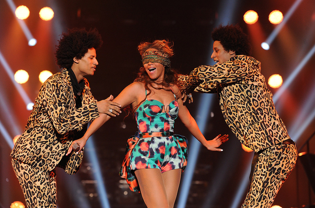 ". Singer Beyonce performs the song ""Grown Woman\"" with dancers \""Les Twins\"" on her \""Mrs. Carter Show World Tour 2013\"", on Wednesday, April 24, 2013 at the Palais Omni Sport Bercy in Paris, France. Beyonce is wearing a custom printed romper with bustle by designer Kenzo. (Photo by Frank Micelotta/Invision for Parkwood Entertainment/AP Images."