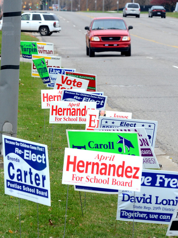 . Campaign signs outside the Ruth Peterson Senior Center in Pontiac.   Tuesday, November 4, 2014.  Tim Thompson-The Oakland Press