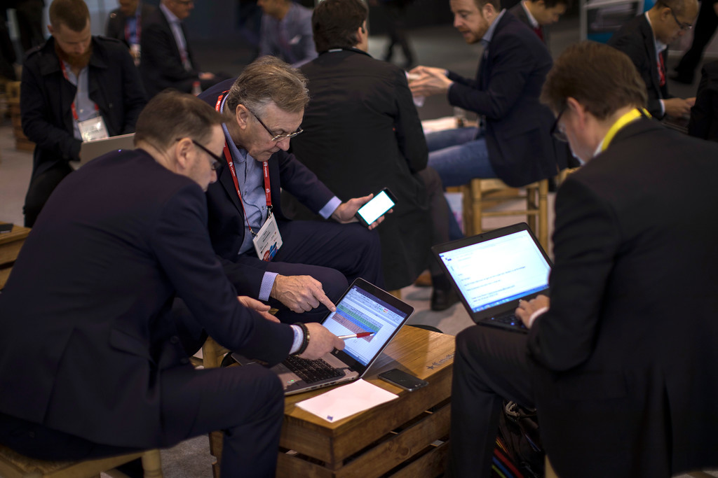 . Visitors use their computers and smart phones as they meet at the Mobile World Congress wireless show, in Barcelona, Spain, Monday, Feb 26, 2018. The annual Mobile World Congress (MWC) runs from 26 February - 1 March and draws over 2,300 exhibitors to Barcelona, including industry heavyweights Samsung, Huawei and Nokia. (AP Photo/Emilio Morenatti)