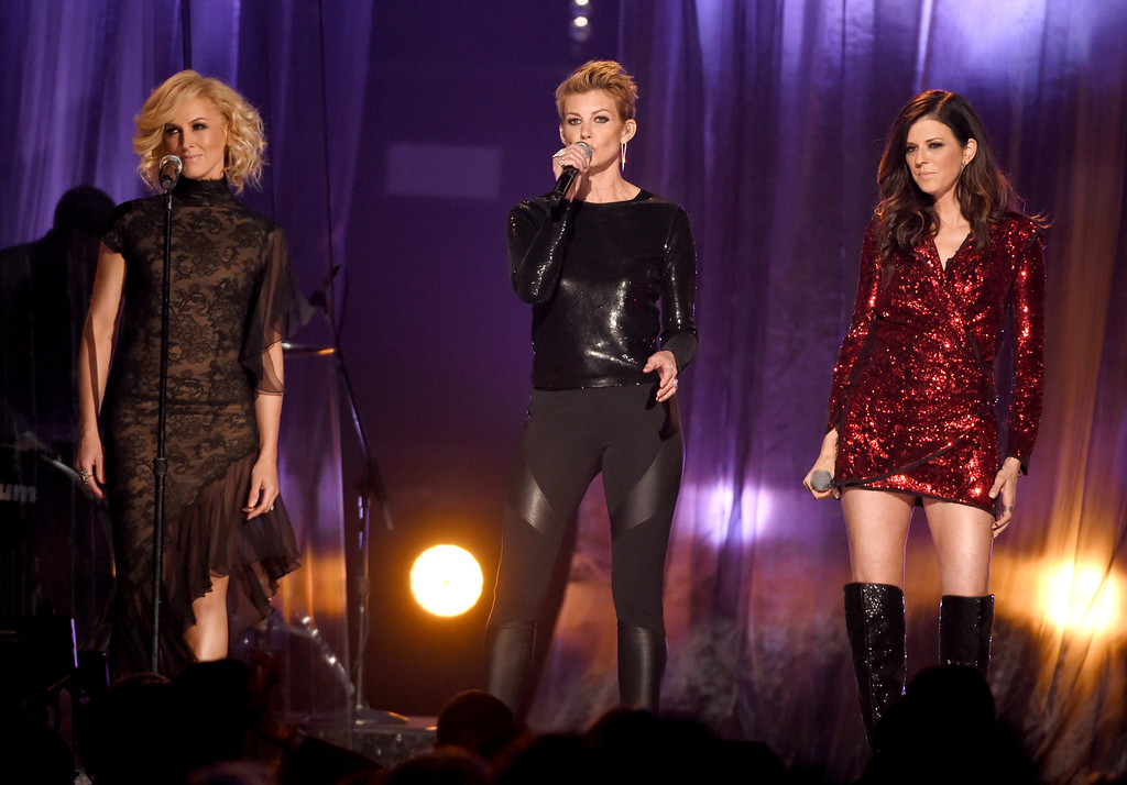 . Kimberly Schlapman, from left, Faith Hill, and Karen Fairchild perform at the Billboard Music Awards at the MGM Grand Garden Arena on Sunday, May 17, 2015, in Las Vegas. (Photo by Chris Pizzello/Invision/AP)